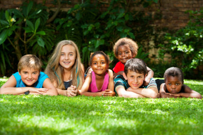 Diverse group of kids together in garden